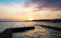 Sunset from the Island (LaPille) Tags: sunset italy lake water reflections outdoor sunsetonwater romantic goldensunset umbria goldenlights trasimenolake romanticsunset