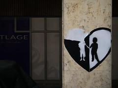 Ripped Heart (H.H. Mahal Alysheba) Tags: germany munich münchen snapshot street lumix gx7 lumixg 1260mmf3556