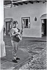 Joven Músico (Young Musician) (Samy Collazo) Tags: argus c3 1955 guitarra guitar musico musician musica music streetphotography fotografiacallejera sanjuan oldsanjuan viejosanjuan puertorico callefortaleza fortalezastreet bn bw aviary lightroom epsonperfectionv500scanner niksilverefexpro2 blackandwhite pb