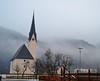 pink church (ekelly80) Tags: germany bavaria december2016 kreuth snow winter town church pink steeple tower mountains alps fog clouds view