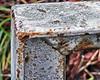 Corner. (karl from perivale) Tags: corner fence iron paint outdoor angle macromonday macromondays macro metal rust old texture