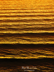 sea wave ripples at sunset (Mimadeo) Tags: ocean sunset sea summer orange sunlight seascape reflection nature water beautiful lines sunshine vertical landscape evening pattern ripple background wave sunny