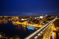 Porto (Yann OG) Tags: longexposure bridge light sunset portugal night river dusk explore porto citylights douro pont bluehour crépuscule nuit coucherdesoleil fleuve grandangle poselongue heurebleue pontededluis