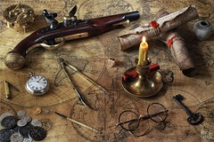The Pirate Captain's Cabin (memoryweaver) Tags: stilllife pirates parchment sundial pirate cartography nautical worldmap navigation compass oldfashioned flintlock nauticalequipment treasuremap denix piratetreasure oldmaps marinecompass denixreplica memoryweaver
