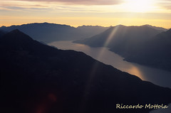 Como Lake from Valtellina (riccardo_mottola) Tags: winter light sunset italy lake mountains yellow evening flying view dusk scenic aerial rays orobie lagodicomo valtellina lombardy lario prealps leicar4