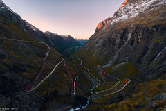 Going up (Ron Jansen - EyeSeeLight Photography) Tags: trollstigen møreogromsdal romsdalen rauma norway autumn serpentine road mountain pass hairpin bend bendy view sunset longexposure car cartrails light d810 haida filters 3 stopper