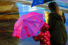 Looking for Muddy Puddles? (stephenbryan825) Tags: child limestreet liverpool abstracts color graphic mother multicoloured pavement people rain reflection selects steps umbrella vivid walking wetpavement