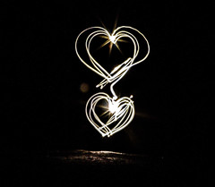 two hearts (PDKImages) Tags: lights torch dark hearts love sparklers sparkle message fizz writing fizzy heart cat face bright daisy flower