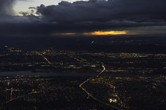 Fly By Night Operation (courtney_meier) Tags: columbiariver oregon pacificnorthwest portland willametteriver airborne evening rainclouds stormclouds sunset