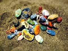 Beach rocks... (Starrgalla) Tags: ocean color beach colors sand rocks colorful pacific shoreline pebbles pebble shore sonomacounty beachrocks beachrock