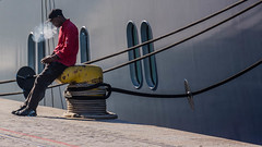 Smoking on the Dock (Erik Pronske) Tags: africa man southafrica dock ship sitting waterfront capetown rope smoking za atlanticocean westerncape