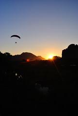 Vang Vieng (makingacross) Tags: laos pdr nikon d3000 vang vieng vangvieng mountains sky trees sunset paraglider nam song river namsong