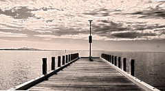 Jetty (jezselten) Tags: jetty outside watersea ocean pier australia geelong victoria blackandwhite clouds sky day peaceful quiet walk walking view urban harbour wood wooden slats decking deck old poles