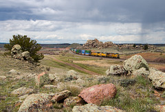 Sherman Hill in May (Wheelnrail) Tags: train trains up union pacific locomotive emd ge wyoming sherman hill intermodal dale autorack overland route yellow skies rain spring storm high country desert mountains