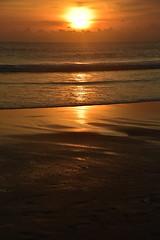 Sunset, Bali. (Manoo Mistry) Tags: nikond5500body nikon bali seminyak tamron18270mmzoom holiday tourism sunset orange beach sea waves outdoor indonesia flicker