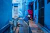 Jodhpur Alleys (ujjal dey) Tags: ujjal ujjaldey jodhpur rajasthan alleys blue bluecity streets woman lady water cleaning fujifilm xe2s travel