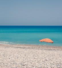 (micahmoreland) Tags: spain beach sea ocean summer rocks water blue beautiful umbrella minimalist