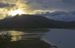 Fisherman's sunset (Pratik Bhakkad) Tags: travel blue sunset india water yellow clouds composition canon landscape evening boat fishing fisherman colours monsoon maharashtra pune sahyadri canon550d