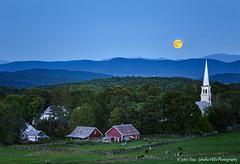 Blue Moon Over Peacham Vermont (Jericho Hills Photography) Tags: moon church beautiful barn cows farm steeple pasture moonrise woodenfence serene nightsky lunar redbarn bluemoon fenceline farmlife landscapephotography peacham vermontvermontscenic bluehourfarm
