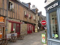 Brittany. Dol de Bretagne. Alleyway, cafe (Traveling with Simone) Tags: road door old houses france building caf architecture town cafe brittany outdoor cobblestones alleyway storefront passage smalltown canonpowershot gasse opticien reddoors illeetvilaine