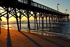 Myrtle Beach Pier (ethancempe) Tags: morning red orange beach water yellow sunrise pier nikon waves d3100