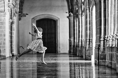 Flying girl (Javier Palacios Prieto) Tags: vanish archs architecture jump girl air dress black white ballet child hands