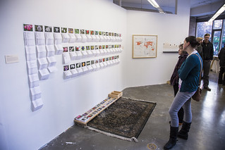 Susan Dicken Looks at a List of Flowers from Guantánamo Detainees' Home Countries