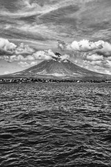 Mayon Volcano (FotoGrazio) Tags: composition nature water fotograzio highcontrast moody digitalphotography capture majestic ocean waynegrazio photography photographicart sky mayonvolcano fineart landscape waynesgrazio albay photoshoot art bicol legazpi phototoart volcano flickr clouds sandiegophotographer philippines scenic worldphotographer californiaphotographer beautiful photographersinsandiego explore internationalphotographers 500px artofphotography photographersincalifornia contrast blackandwhite surreal mountain