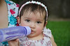 Sip (chrysantemumpee) Tags: baby cute nature girl outside milk bottle infant pretty little drinking houston cutie bebe hermannpark