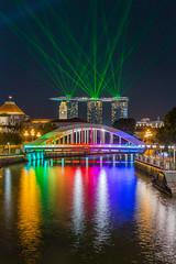 Colorful bridge of Singapore (BP Chua) Tags: show city travel bridge light reflection water colors night river rainbow singapore colorful cityscape parliament laser birdge mbs autofocus marinabay marinabaysands
