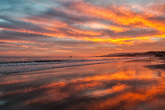 Sunset Colors (beachwalker2008) Tags: ocean sunset red orange reflection yellow pier boat dusk wave 1000 ellwood interestingness76 i500 haskellsbeach