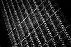 Citi Grid (Skuggzi) Tags: city uk england blackandwhite bw abstract detail reflection london tower geometric window glass monochrome lines metal architecture facade contrast skyscraper grid office europe noir pattern unitedkingdom britain outdoor geometry minimal lookingup lookup diagonal gb reflective docklands hightech rectangle futuristic lattice towerhamlets
