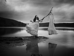 Bait (Maren Klemp) Tags: fineartphotography fineartphotographer darkart darkartphotography blackandwhite fishing dress water ocean lake nature woman selfportrait ethereal surreal conceptual clouds dramatic portrait evocative expressive monochrome dreamy painterly symbolic reflection