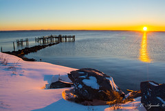 Sunrise (E. Aguedo) Tags: sunrise dock snow warwick winter water ocean sun reflection rocks rocky point park rhode island new england ngc beach