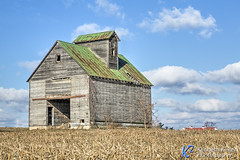 Old Midwestern Crib Barn (Kenneth Keifer) Tags: america americana blue clouds green jeffersonville landscape sky winter agricultural agriculture barn corn cornfield country countryside crib cupola doors dramatic farm farming field grunge harvest metal midwest nature ohio old roof rural rustic rusty scenic stubble sunny tall vintage window wood wooden