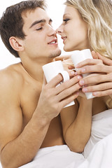 Couple in love with morning coffe (engvnnet) Tags: tea people couple happiness cheerful men women togetherness coffee smiling heterosexual adult love romance young two female beauty flirting cup caucasian embracing male enjoyment dating drink beautiful married heat relaxation bonding family hair loving joy fun drinking indoors leisure activity passion sitting vertical sensuality bedroom nature blond face bed talking