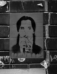 Monochrome girl drinking (PDKImages) Tags: art street manchesterstreetgallery manchesterstreetart streetart contrasts couple love artinthecity ripartist faces abandoned girl bee bees manchester walls posterart stencilart heart hidden dmstff cityscape cityscene