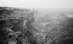 The view past Mesa Arch, Canyonlands National Park, Utah (tsaiproject) Tags: mesaarch potholearch canyonlandsnationalpark utah islandinthesky moab canyons mesa buttes coloradoriver greenriver washerwoman ngc lasalmountains grandviewpointrd facingeast airporttower dawn