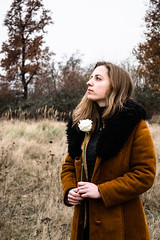 Sunday Mourning (Charles Rommens) Tags: grass autumn portrait maastricht cinematic nature blond brown nikond3300 gaze light clouds trees people girl sintpietersberg hands pondering white coat rose black green woman yellow leaves hair