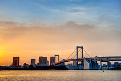 Rainbow Bridge (Clint Koehler) Tags: asia japan nikond700 tokyo bridge rainbowbridge odaiba island water ocean port sunset buildings outdoor sky 50