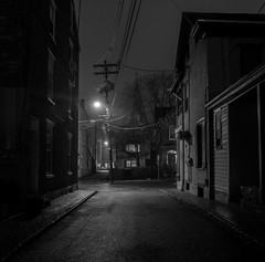 Ghosts Appear and Fade Away (• estatik •) Tags: lambertville nj newjersey george street alley church night longexposure panorama black white monotone monochrome bw telephone pole wires historic downtown blackandwhite blackwhite lonely alone dark darkness lights streetlight utility intersection notcurne