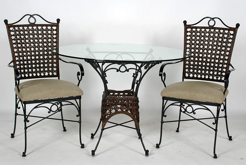 Glass Top Table w/4 Iron & Rattan Chairs ($242.00)