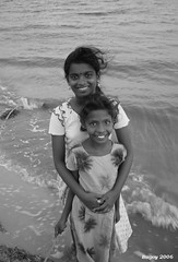 happiness (thephatone_pics) Tags: girls sea water smile children happy sri lanka peopleofsrilanka childrenofsrilankabw