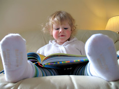 Reading (SageCrayon) Tags: reading book toddler little daughter miss babyfeet kj 2yearsold doratheexplorer babylegs 27monthsold