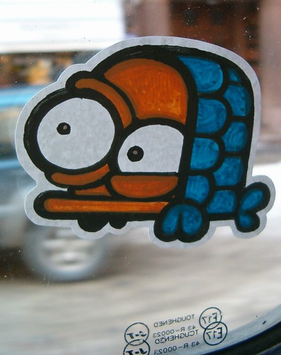 sticker art of a turtle with one bulging eye