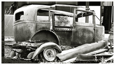 Getaway Car (Domain Barnyard) Tags: old bw abandoned car rural vintage wow interesting lasvegas nevada bestviewedlarge 2006 canoneos20d transportation bloggers blkwht wrecked tingey score50 topphotoblog ftfr 123bw judgementday50