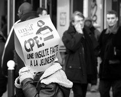 "March 18, 2006 - 16:51: ""Une insulte  la jeunesse"" (Hughes Lglise-Bataille) Tags: blackandwhite bw paris france protest photojournalism olympus 2006 demonstration manifestation cpe e500"