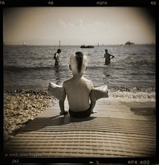 Mohawk Boy at the Lake (Sen Duggan (aka f/1.4)) Tags: boy summer lake sepia swimming germany holga child explore mohawk toned bodensee tinted lakeofconstance i500
