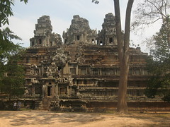 Bayon temple at Angkor - Cambodia (Sarah Ann Wright) Tags: old building travelling architecture temple asia cambodia southeastasia buddhist buddhism angkorwat jungle siemreap angkor tombraider isolated crumbling bayon bayontemple bayonfaces