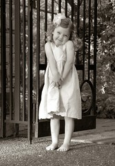Standing Outside the Gate (Larry Tolleson) Tags: blackandwhite gardens kids children outdoors botanicalgardens photodotocontest1